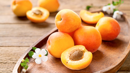 Fresh apricots on a tray